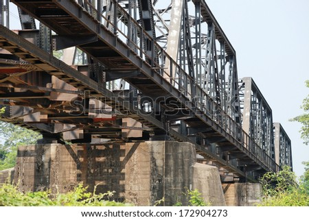 Railroad track on steel bridge and concrete foundation supporting  #172904273