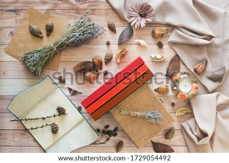 Cozy autumn composition. Still life details of home interior on a wooden table with books, home atmosphere. Living room #1729054492