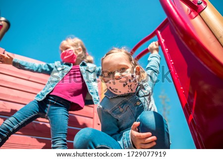 Happy children in eastern europe playing with face masks on playground during quarantine covid19. Slovakia Royalty-Free Stock Photo #1729077919