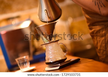 Made a coffee by mixing the coffee and hot water  at the right dose. #1729103731