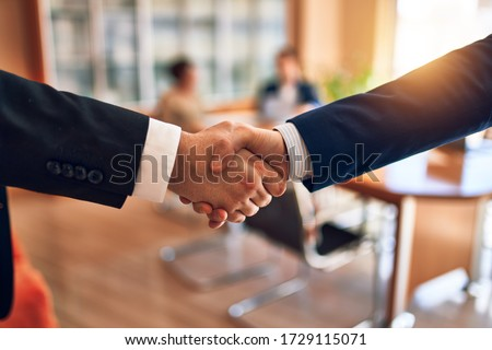 Business lawyers workers meeting at law firm office. Professional executive partners working on finance strategry at the workplace. Shaking hands for succesful agreement. #1729115071