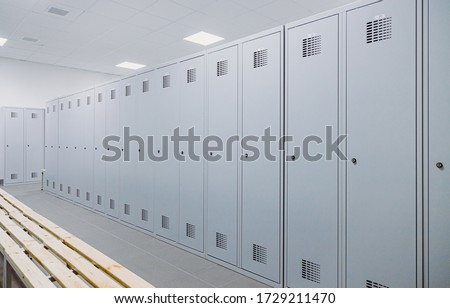 White lockers in a changing room Royalty-Free Stock Photo #1729211470
