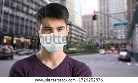 Man in city street wearing face mask protective for spreading of Coronavirus #1729252876