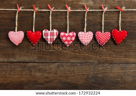 Gingham Love Valentine's hearts natural cord and red clips hanging on rustic driftwood texture background, copy space Royalty-Free Stock Photo #172932224