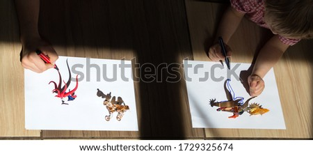 children draw contrasting shadows from small animal toy figures along the contour with a felt-tip pen. drawing of a preschooler, ideas for the development of creative thinking. Interesting events