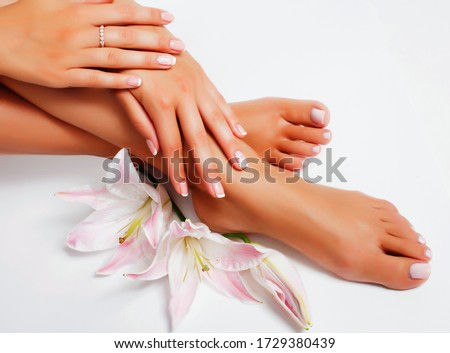 manicure pedicure with flower lily closeup isolated on white background perfect shape hands spa salon Royalty-Free Stock Photo #1729380439