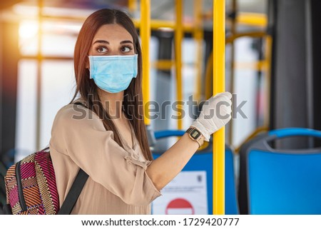 A young woman on public transport during the pandemic. A young woman in an empty public transport during the pandemic. Coronavirus. Virus protection in public transportation #1729420777