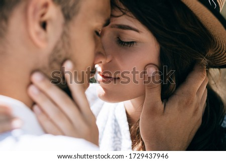 A young couple in love hugs and kisses