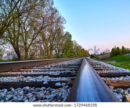 Train Track closeup picture; railroad tracks blue sky