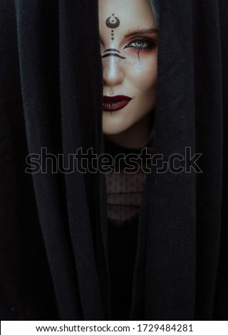 Witch in black. Girl with Makeup and character for Halloween. Royalty-Free Stock Photo #1729484281