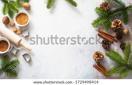 Christmas and New Year background with baking ingredients, cones and fir twigs. Flat lay. Copy space #1729498414