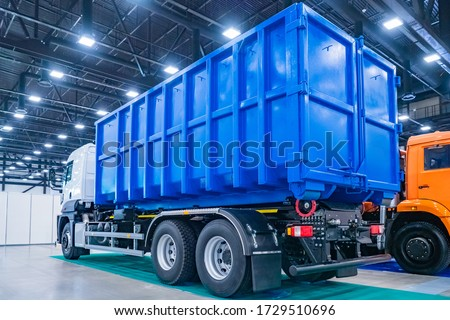 Equipment for public utilities. Truck for the removal of large-sized garbage. Municipal economy. The trash bin is mounted on the truck. Removal of construction debris. #1729510696