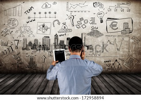 Businessman using tablet and phone on the business concept background #172958894