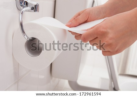 Close-up Of A Person's Hand Using Toilet Paper #172961594
