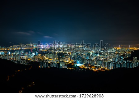 panorama cityscape view of Hong Kong at night, the atmosphere of night lights in the city of the harbor, trade, transportation and international export #1729628908