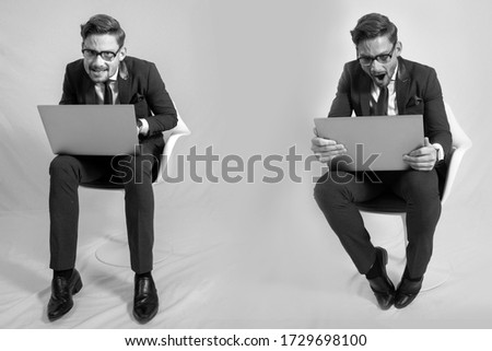 nerdy men with attitude and expression sitting on a chair white background