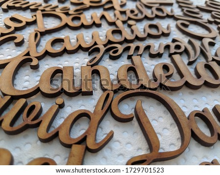 names and letters made of wood on white surface