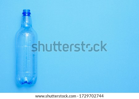 Used plastic bottles on the blue background. Recycling concept #1729702744
