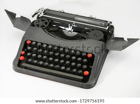 Old typewriter on white background. #1729756195