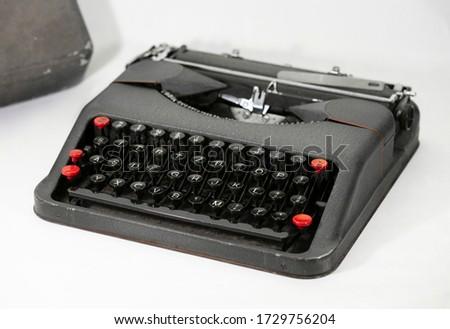 Old typewriter on white background. #1729756204