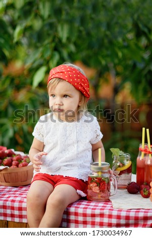 strawberry lemonade with ice and mint as summer refreshing drink in jars. Lemonade Stand. Adorable little girl trying to sell lemonade. Cold soft drinks with fruit. Child drinking lemonade in jar #1730034967