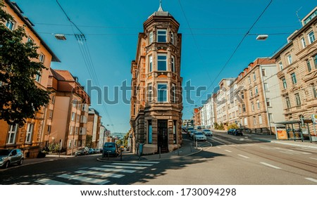 Stuttgart, Germany, June, 2015, Flat building in center of street inside stuttgart city at Eugensplatz square, a popular meeting place for people. Architecture reminding of flatiron building in New Yo #1730094298