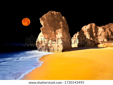 beach in  Portimao is a favorite vacation spot for the Portuguese and visiting Europeans. Clean sand, warm sea and beautiful cliffs on the coast attract tourists. Infrared art photography.