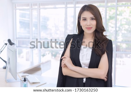 Work from home. Beautiful office lady standing and smiling at work happily. Royalty-Free Stock Photo #1730163250