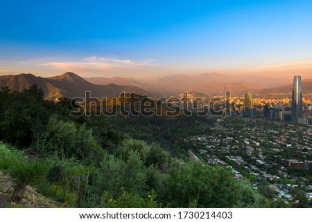 Panoramic view of Santiago with Parquemet Metropolitan park and Cerro Manquehue at sunset, Santiago de Chile, Chile Royalty-Free Stock Photo #1730214403