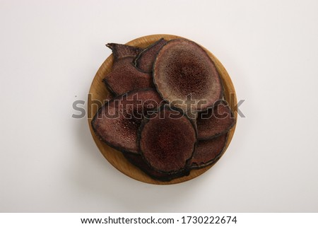 Deer antler on a round wooden bowl. Royalty-Free Stock Photo #1730222674
