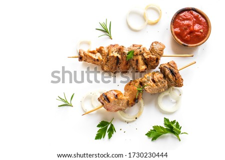 Grilled pork skewers isolated on white background, top view. Meat pork, chicken or turkey shish kebab with tomato sauce,  herbs and spices. #1730230444