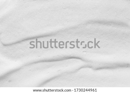 Cosmetic foam texture background. Soap, cleanser, shampoo, shower gel foam texture. White hygiene cleansing product smear smudge Royalty-Free Stock Photo #1730244961