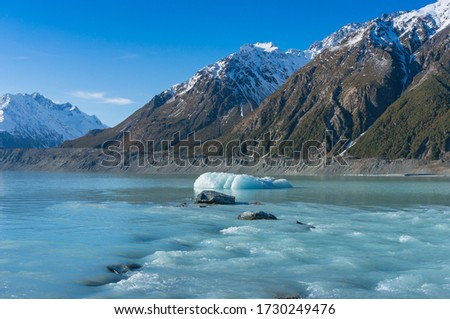 Winter mountain landscape with cold icy blue river waters and ice icebergs. Winter landscape of Tasman river and lake in Mount Cook National Park, New Zealand  #1730249476