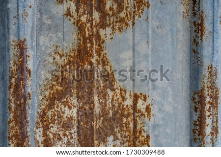 Rust. Fragment of a rusty metal surface. Macro photo. Grunge texture. Red rusty stains on iron. Rock texture. Rust texture. Abstract grunge background. Rust on a metal flooring. #1730309488