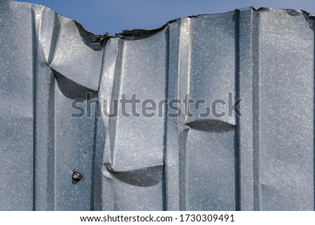 Fragment of a metal flooring. Macro photo. Metal flooring. Surface texture of the protective coating. Relief and folds on a sheet of metal corrugated cardboard. Rough metal surface. #1730309491