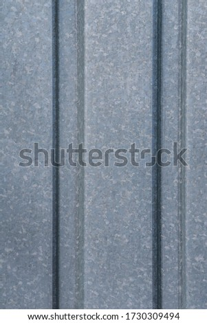 Fragment of a metal flooring. Macro photo. Metal flooring. Surface texture of the protective coating. Relief and folds on a sheet of metal corrugated cardboard. Rough metal surface. #1730309494