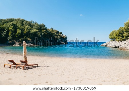 A deserted beach in Montenegro. Quiet bay in the Adriatic Sea am Royalty-Free Stock Photo #1730319859