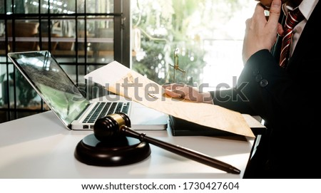 Business and lawyers discussing contract papers with brass scale on desk in office. Law, legal services, advice, justice and law concept  picture with film grain effect #1730427604