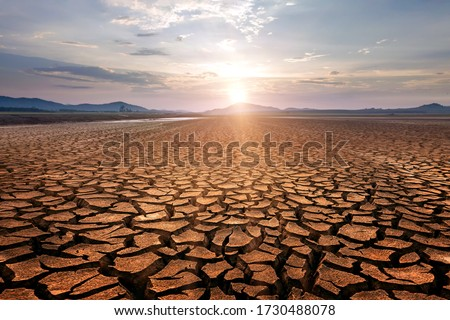 Global warming concept . Dry cracks in the land, serious water shortages. Drought concept. Royalty-Free Stock Photo #1730488078