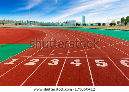 red plastic runway and numbers in a sports ground #173050412
