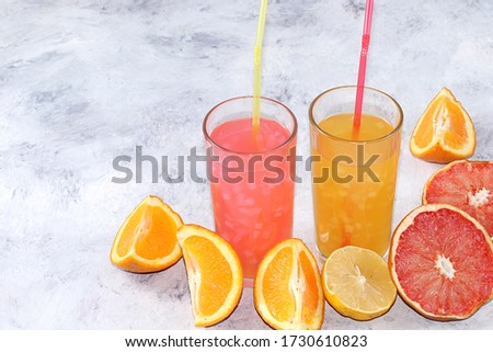 Assortment of fruit juices and ingredients on a sunny table. The concept of detox diet and weight loss, healthy and natural nutrition, bar, lifestyle. Summer vitamin drinks. #1730610823
