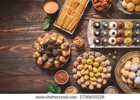 Arabic Cuisine; Cookies for celebration of El-Fitr Islamic Feast.(The Feast that comes after Ramadan). Varieties of Eid Al-Fitr sweets(kahk,biscuits, petit four). Top view with copy space. #1730650228