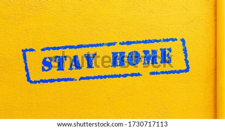 Animation of blue stay home stamp during covid-19 on yellow background. Animated coronavirus concept. Illustration of coronavirus warning. Pandemic outbreak.