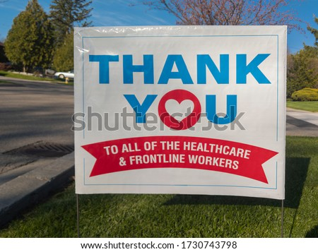 Thank you to all the healthcare and frontline workers sign at front lawn during corona virus pandemic outbreak. Selective focus. Emergency workers, first responders, health care workers appreciation.