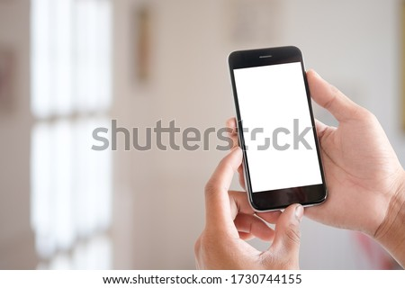 Cropped shot view of man hands holding smart phone with blank copy space screen for your text message or information content, female reading text message on cell telephone during in urban setting.  #1730744155