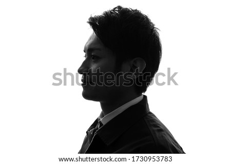 Silhouette of young asian businessman. Royalty-Free Stock Photo #1730953783