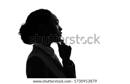 Silhouette of young black woman thinking something.