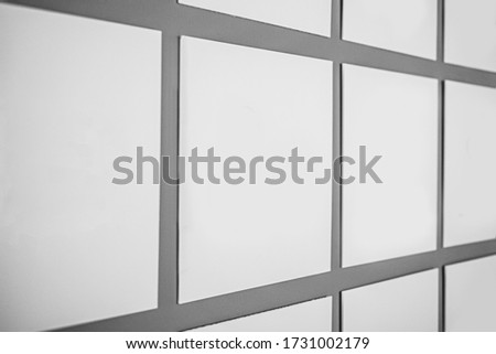 Blank white weather-resistant signs, posters, sheets. Multiple white empty advertising banners on grey background. Mock up. Side view