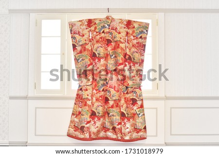A traditional Japanese wedding kimono hanging in a Japanese bride's room. Royalty-Free Stock Photo #1731018979