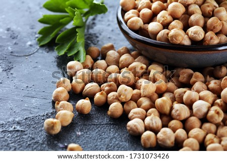 Raw Chickpeas in a bowl. Chickpeas is nutritious food. Healthy and natural vegetarian food #1731073426